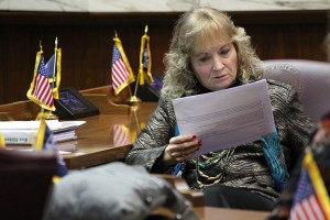 State Superintendent Glenda Ritz reads through a report drafted by her colleagues on the 2015 Blue Ribbon Commission. (Photo Credit: Rachel Morello/StateImpact Indiana)