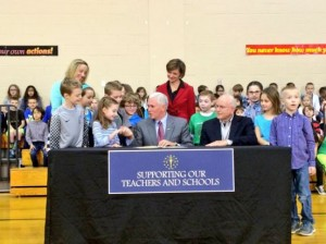 Gov. Pence signed HEA 1395 at Eagle Elementary School in Zionsville. The law gets rid of ISTEP+ by 2017 and creates a committee that will determine the replacement.