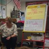 Frankfort teacher Anne Lanum works with English learner students.