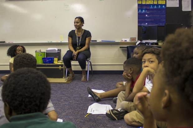 Ayana Coles sits with her students at Eagle Creek Elementary School. (Peter Balonon-Rosen/Indiana Public Broadcasting)