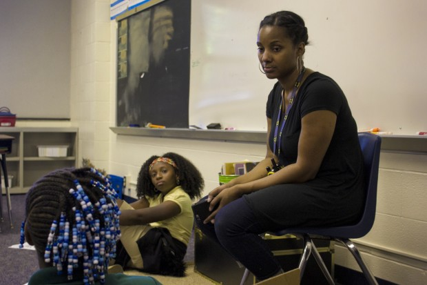 Ayana Coles sits with her students at Eagle Creek Elementary School.  At Eagle Creek, students of color make up 77 percent of the student body. Yet, all but four of the school's 37 staff are white. Coles has led conversations about race with colleagues throughout the year. (Peter Balonon-Rosen/Indiana Public Broadcasting)