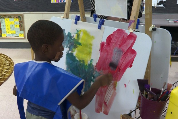 A student paints on an easel at Day Early Learning in Indianapolis. This preschool is run by Early Learning Indiana, which is advocating for state funded pre-k for low income families.