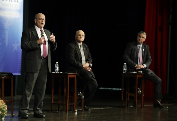 Democrat John Gregg, left,  responds to a question during a debate for Indiana Governor, Tuesday, Sept. 27, 2016, in Indianapolis. Libertarian Rex Bell and Republican Lt. Gov. Eric Holcomb also participated in the debate. (AP Photo/Darron Cummings, Pool)
