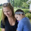Kendra Bowden and her son Wyatt, 3, on their porch. Wyatt has had cochlear implants for most of his life. (Peter Balonon-Rosen/Indiana Public Broadcasting)
