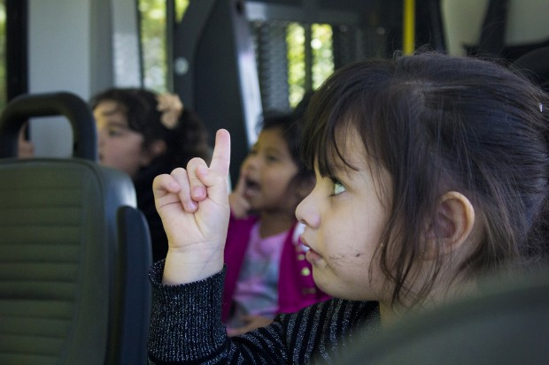 A student sings and makes hand gestures on the way home. (Peter Balonon-Rosen/Indiana Public Broadcasting)