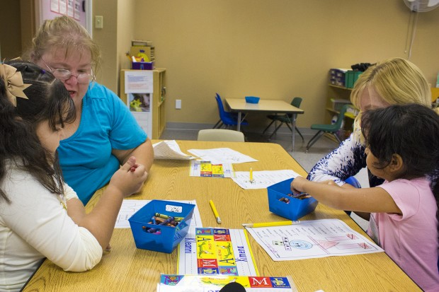 Teachers work one-on-one with students during a math lesson. (Peter Balonon-Rosen/Indiana Public Broadcasting)