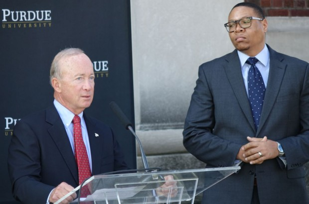 Purdue University President Mitch Daniels discusses the Purdue Polytechnic High School at its future home in the PR Mallory Building, 3029 E. Washington St., on the east side of Indianapolis as Indianapolis Public Schools Superintendent Lewis Ferebee listens on Monday, Oct. 3, 2016. The charter school will be part of the IPS district under a contract that makes IPS accountable for student's state funding and their academic outcomes. (Eric Weddle/WFYI)