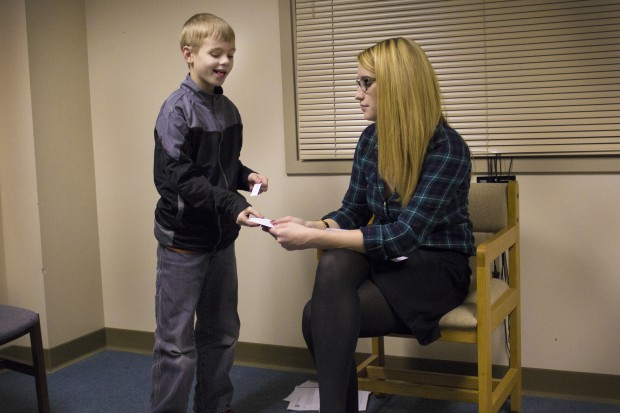 Shaw, 8, plays an improv game with Erin McTiernan, an Indiana State University doctoral student. Shaw is a participant in an improv class at Indiana State University for children with high functioning autism. (Peter Balonon-Rosen/Indiana Public Broadcasting)