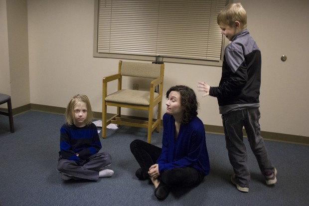 The improv theater class at Indiana State University's psychology clinic. Rachel Magin, center, created the class to help children with autism learn social skills and practice reading others' emotions. (Peter Balonon-Rosen/Indiana Public Broadcasting)