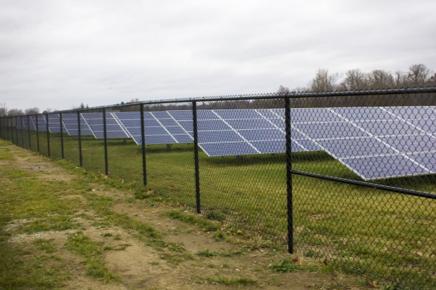 A row of solar panels lies behind Sheridan Elementary School. (Peter Balonon-Rosen/Indiana Public Broadcasting)