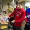 Reagan Roush, center, makes a creamy chicken fajita pasta dish at a weekly cooking skills class at the College Internship Program in Bloomington, IN. (Peter Balonon-Rosen/Indiana Public Broadcasting)