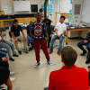 Students in Andy Slater's science class start the morning by playing a word game. Students jump up to move to an open seat if they agree with what the standing student says – sort of like musical chairs. (Eric Weddle/WFYI)