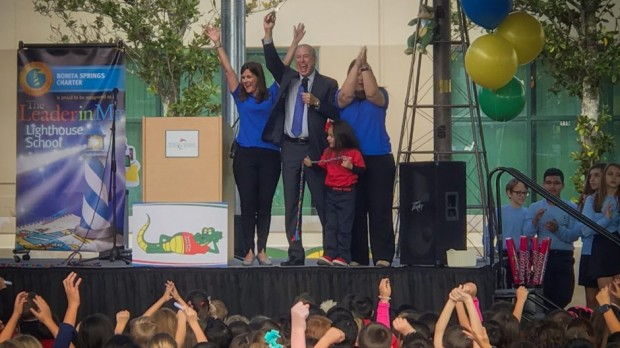 Charter Schools USA CEO Jonathan Hage, center, celebrates an academic recognition for Bonita Springs Charter School in Bonita Springs, Fla. in February 2017. (Credit: Charter Schools USA)