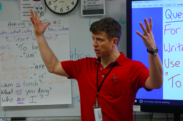Science teacher Andy Slater talk to his ninth grade class about the earth's core during a January morning at the Newcomer Program. (Eric Weddle/WFYI News)