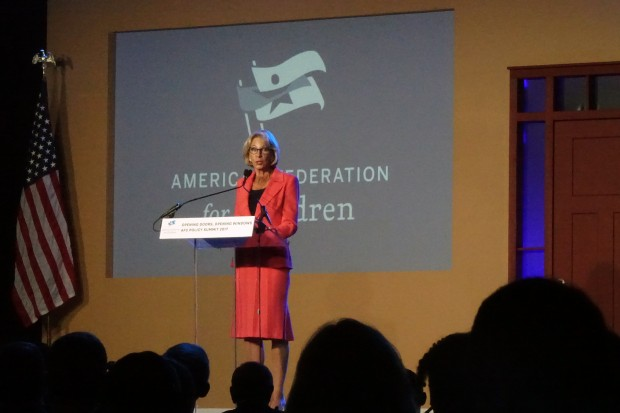 "Secretary of Education Betsy DeVos praises Indiana's choice laws at an event in Indianapolis Monday. She alluded to a forthcoming federal choice program, calling it ""expansive""."