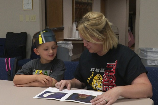 Danielle Reynolds and her son Jackson work on reading skills following his graduation from UPSTART. (photo credit: Lindsey Wright/WTIU News)