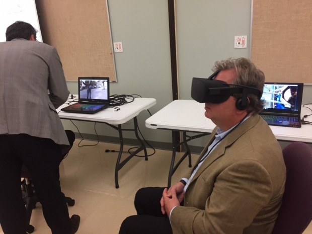 State Sen. Brandt Hershman (R-Buck Creek) tries on an Oculus Rift virtual reality headset at Hope Academy in Indianapolis on Thursday, Aug. 10, 2017. (Eric Weddle/WFYI News)