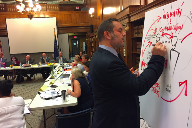 Mike Fleisch illustrates and takes notes on the discussion by the Graduation Pathways Committee members Aug. 23, 2017 at the Indiana State Library in Indianapolis. (Eric Weddle/WFYI Public Media)