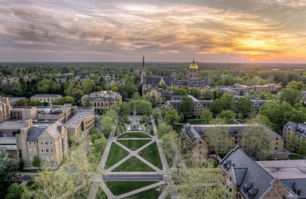 "The University of Notre Dame ranked No. 18 in  U.S. News and World Report's 2018 ""Best Colleges"" list released Tuesday. Here the Basilica of the Sacred Heart and Golden Dome at sunset in 2013. (Barbara Johnston/University of Notre Dame)"