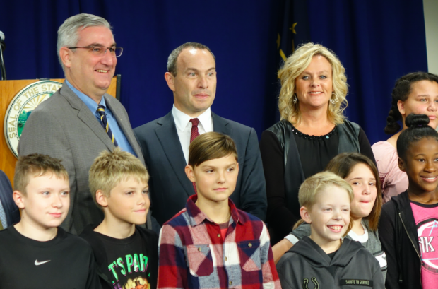 Indiana Gov. Eric Holcomb, EducationSuperHighway CEO Evan Marwell and State Superintendent of Public Instruction Jennifer McCormick annouce a partnership to improve high-speed broadband access to Indiana schools on Tuesday, Oct. 24, 2017 at Metropolitan School District of Decatur Township's Blue Academy. (Eric Weddle/WFYI News)
