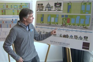 NEAR director John Franklin Hay shows the plan for the teachers' village, which broke ground in November of last year. (Steve Burns/WTIU)