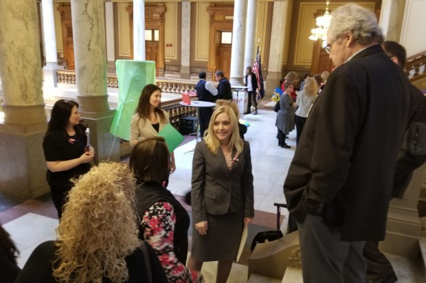 Sen. Erin Houchin (R-Salem) meets with supporters of her dyslexia bill after a hearing in the House. (Jeanie Lindsay/IPB News)