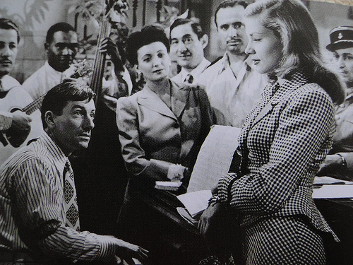 Still photo of Hoagy Carmichael and Lauren Bacall in the 1944 film TO HAVE AND HAVE NOT.