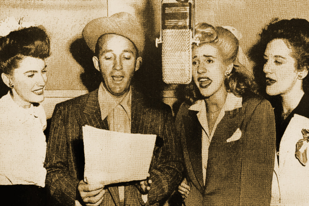 """Bing Crosby and the Andrews Sisters, some of the biggest wartime stars, singing together in 1943. They had a hit together in  1944 called """"(There'll Be a) Hot Time in the Town of Berlin (When the Yanks Go Marching In)."""""""