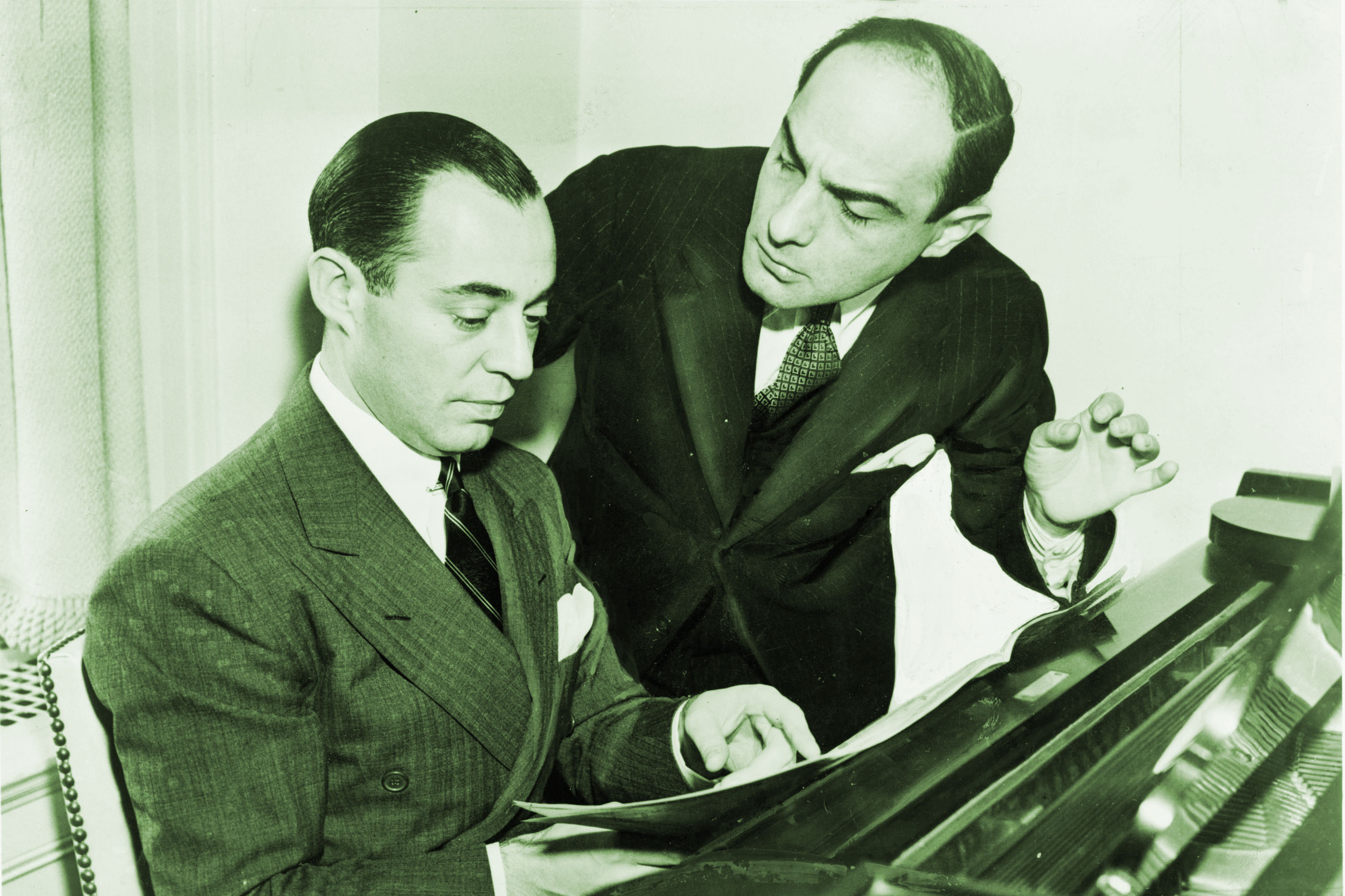 "The stoic Richard Rodgers (at the piano) and the mercurial Lorenz Hart, composers of songs like ""Manhattan,"" ""Isn't It Romantic,"" and ""Blue Moon."""