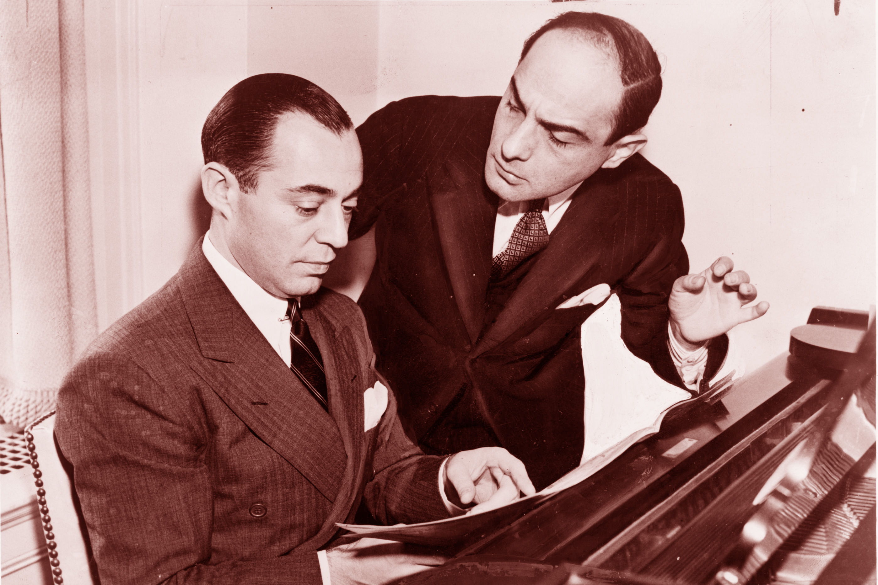 Composer Richard Rodgers (seated) and lyricist Larry Hart collaborated until Hart's untimely death in 1943.