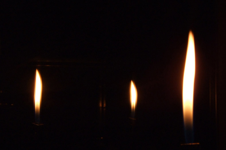 Lit Candle in Dark