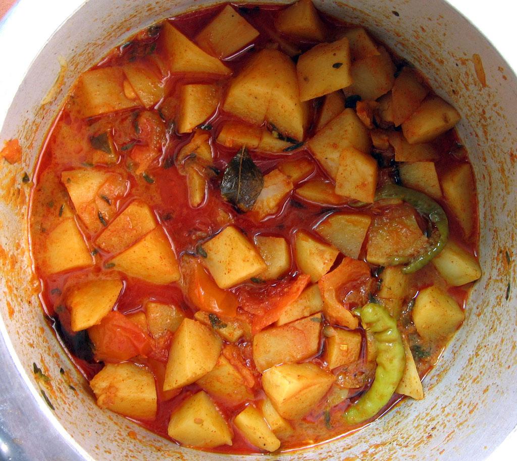 Pressure cooker full of potatoes.