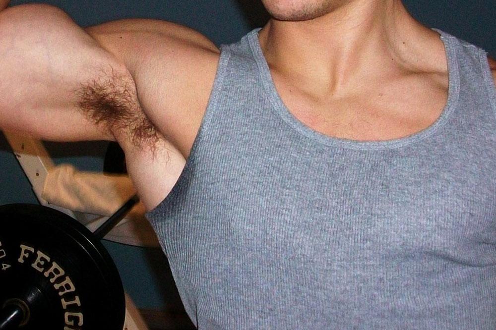 a sweaty man works out