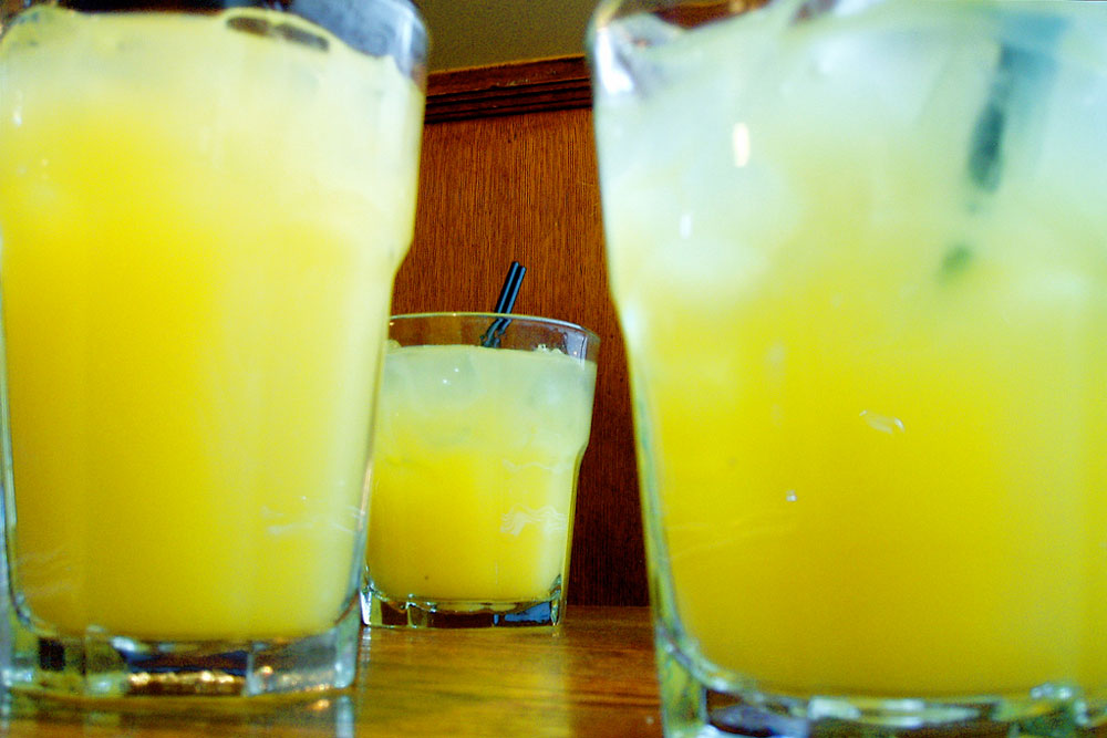 three glasses of orange juice