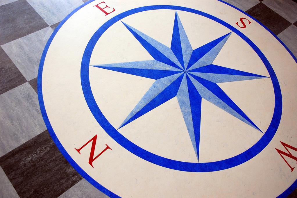 Compass inlay in floor