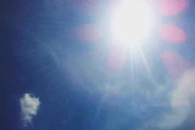 the sun on a day when the sky in blue