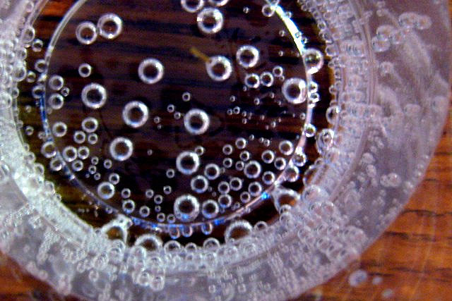 looking down at a glass with carbonation