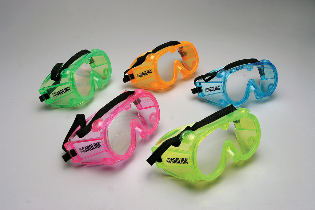 Goggles in different colors on a gray background