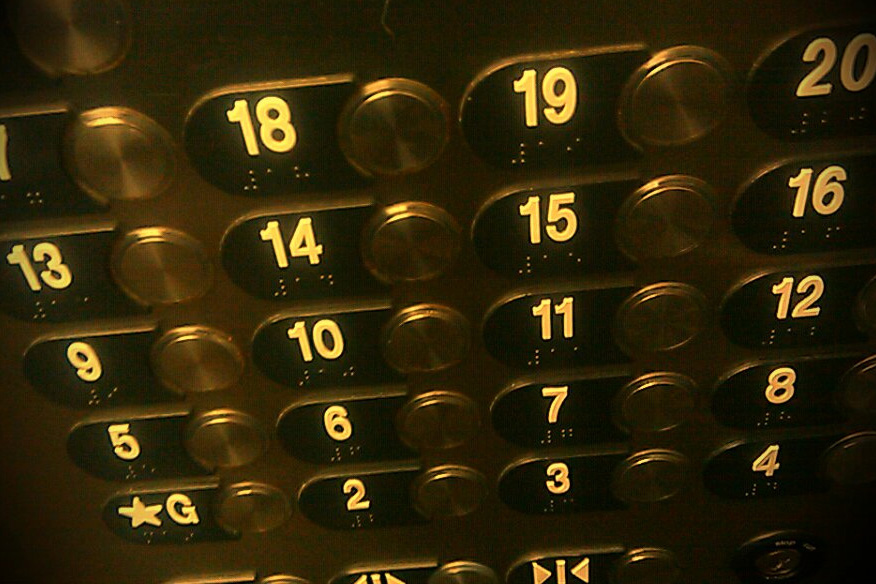 elevator buttons in a row