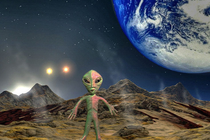 alien toy with earth behind