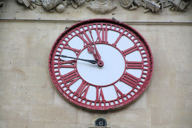 old clock on a wall in Greenwich, London