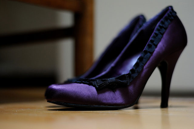 purple heel shoes on a wood floor