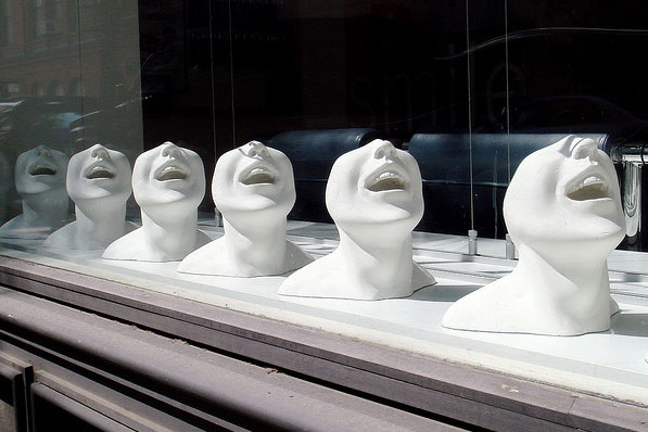 statues of people laughing