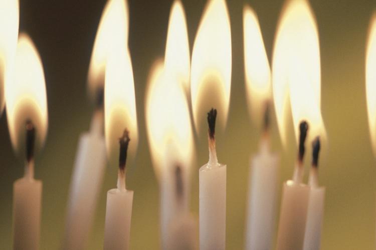 Close-up of burning birthday candles