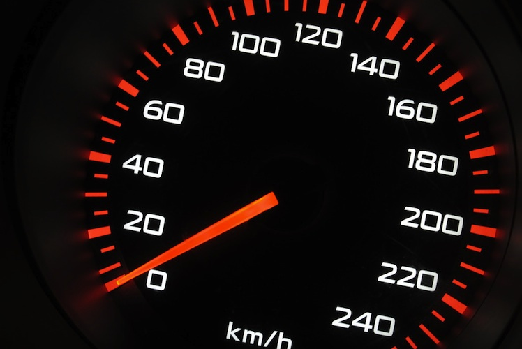 Close up view of a car's speedometer