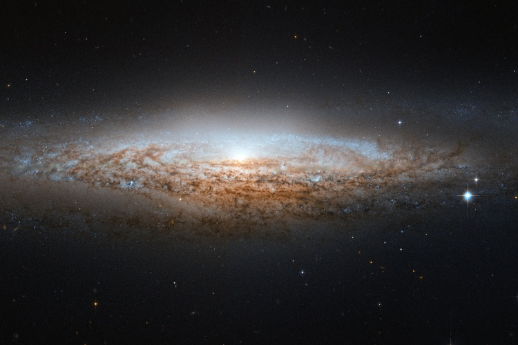 The UFO Galaxy as seen through the Hubble Space Telescope
