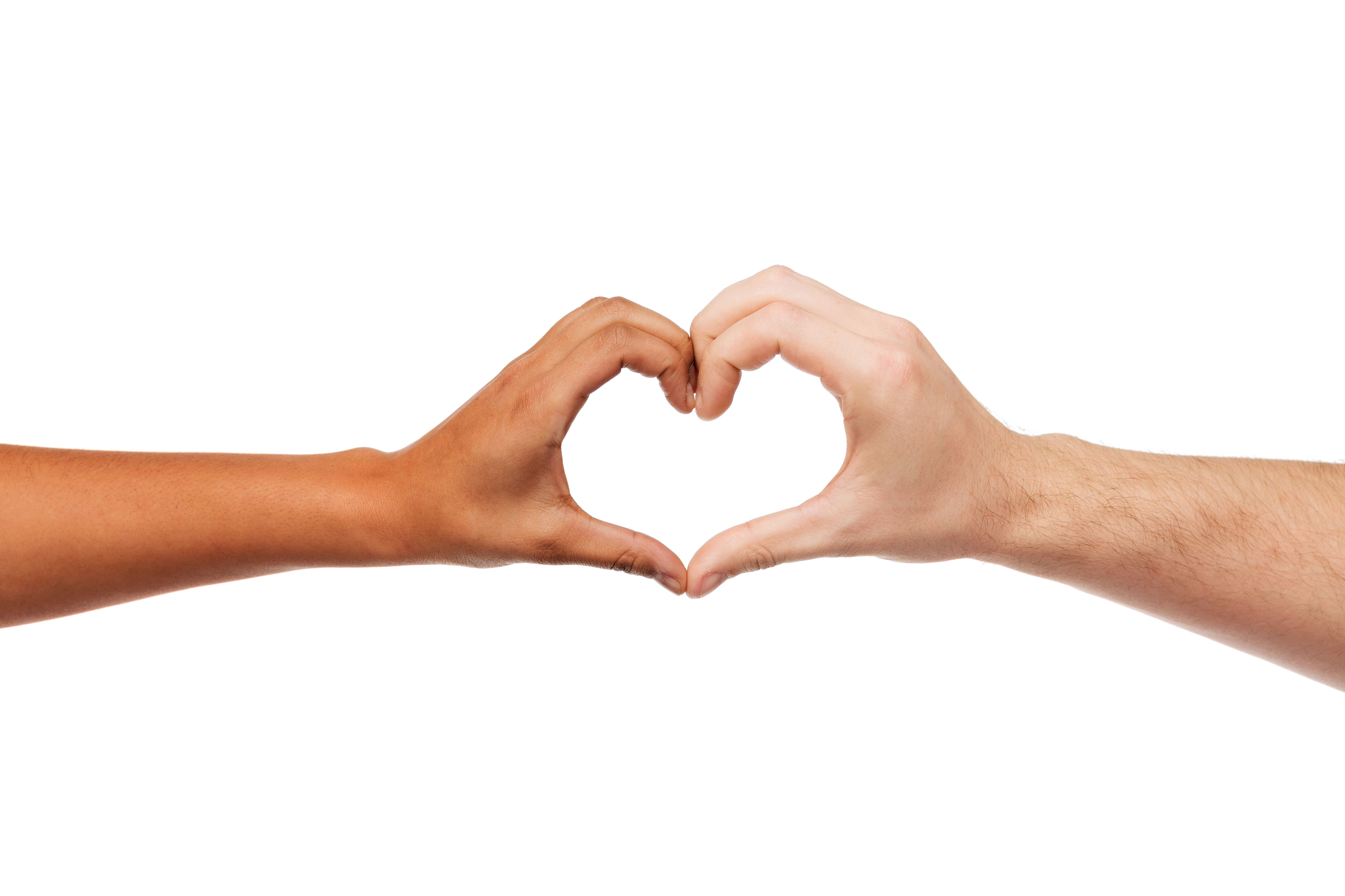 Two hands reach out toward each other to form a heart shape gesture.