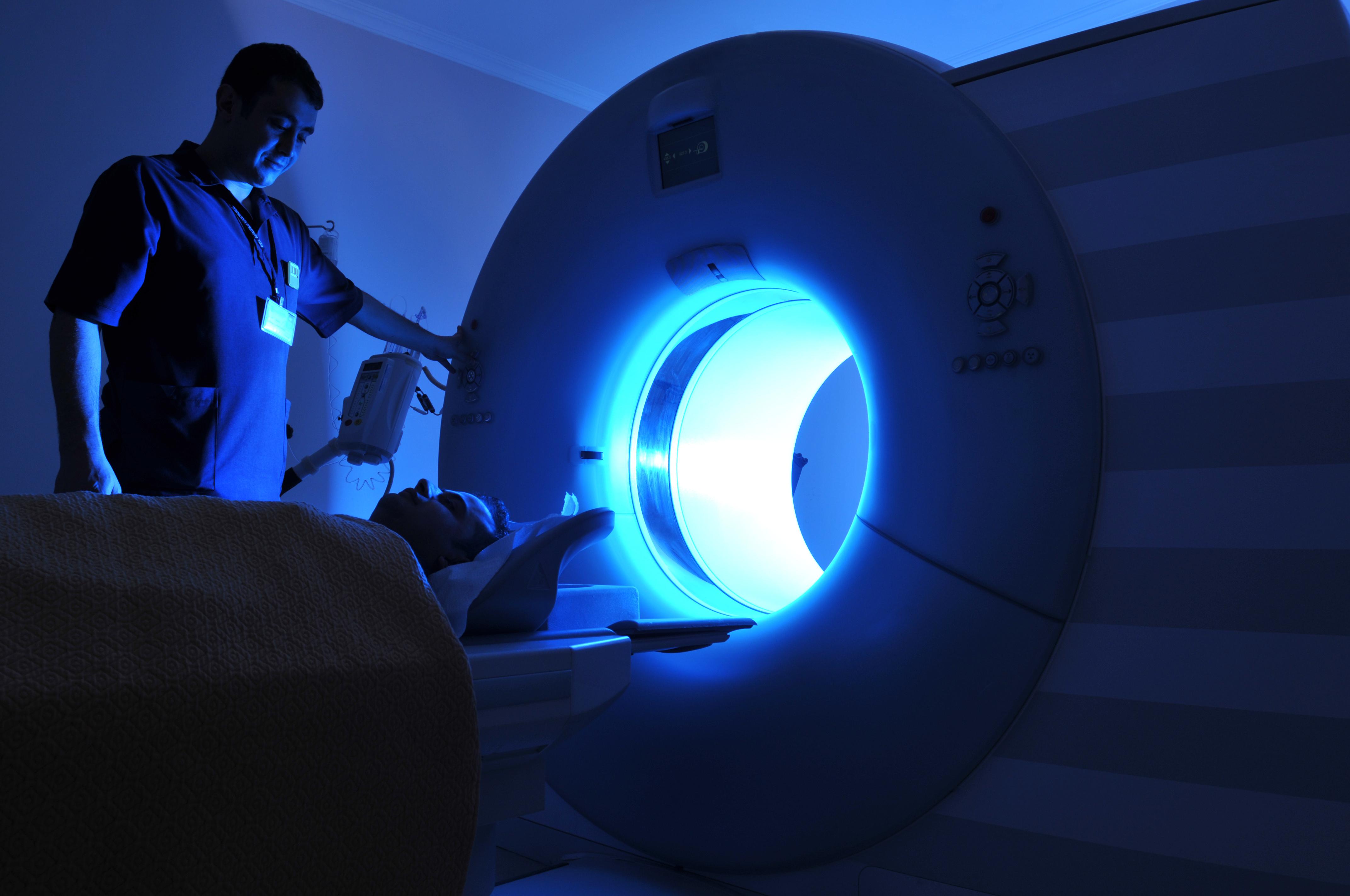 a tech instructs patient before MRI procedure