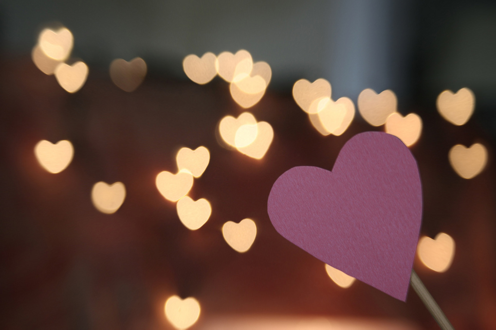 photo of heart lights with one heart in foreground