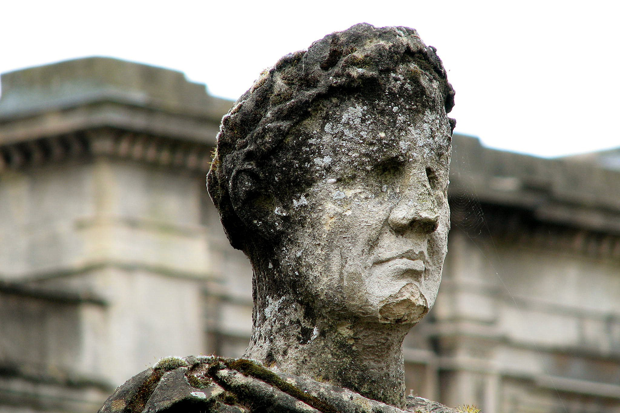 weathered statue at site of Roman bathhouse